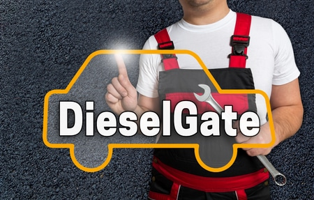 60655369 - dieselgate touchscreen is operated by car mechanics.